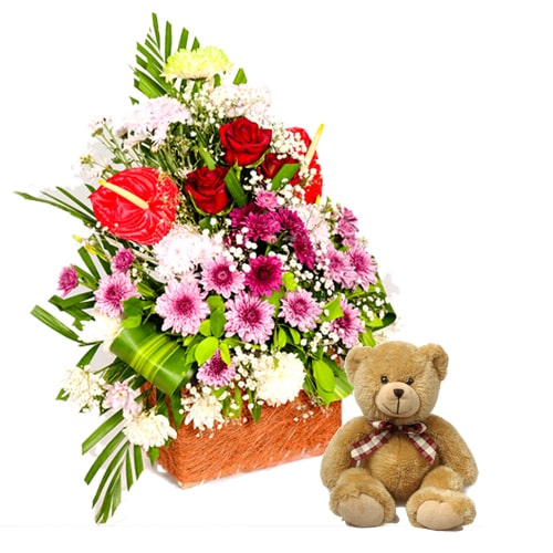 Lovely and Fresh Seasonal Flowers and Teddy Bear in a Rustic Basket